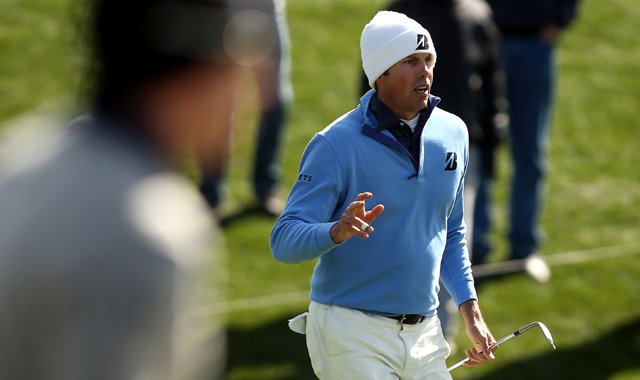 Matt Kuchar (right) reacts after he hit a chip shot onto the green as Hunter Mahan stands in the foreground during the final round of the WGC-Accenture Match Play Championship.