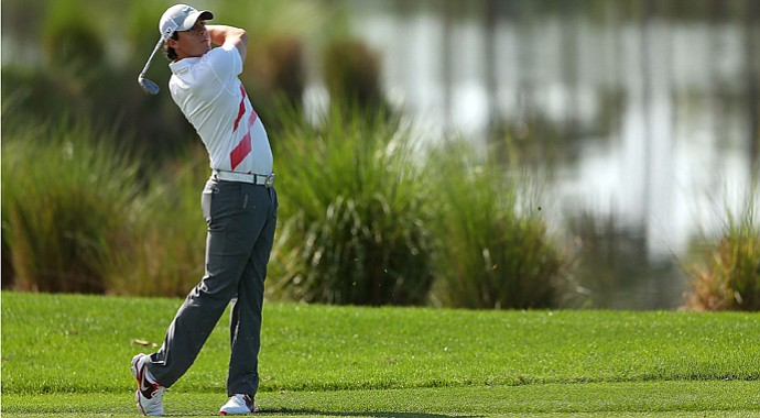Rory McIlroy hits his approach shot on the eighth hole during the first round of the Honda Classic.