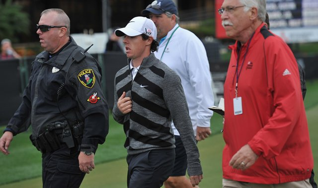 World No. 1 and defending champion, Rory McIlroy walks off the course on the 18th hole. He was 7 over through eight holes.