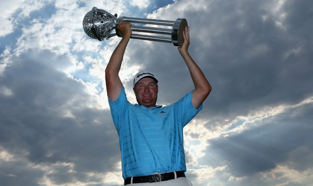Dawie Van Der Walt poses with the trophy after winning the Tshwane Open at Copperleaf Golf &amp; Country Estate.