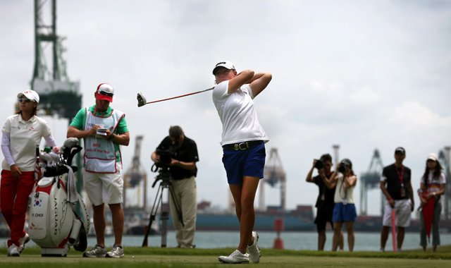 Stacy Lewis tees off on the 7th hole during the final round of the HSBC Women&#39;s Champions. She would eagle the hole.