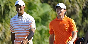 How it happened: Woods fires 65, leads by 2