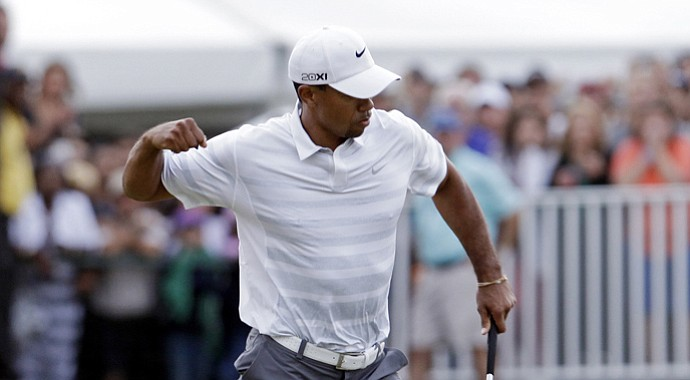 Tiger Woods celebrates a birdie on No. 18 during the third round of the WGC-Cadillac Championship.