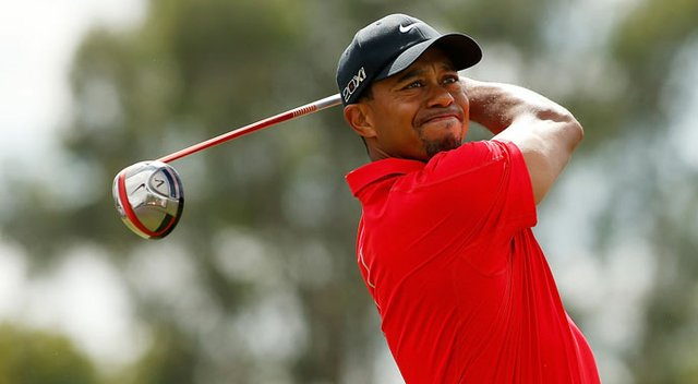 Tiger Woods hits his tee shot on the third hole during the final round of the WGC-Cadillac Championship.