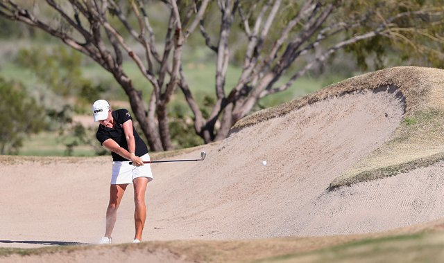 Stacy Lewis hits from the 16th hole bunker during the third round of the RR Donnelley LPGA Founders Cup. Lewis would later receive a two-shot penalty after her caddie, Travis Wilson, tested the bunker prior to this shot. She now trails Ai Miyazato by four shots.