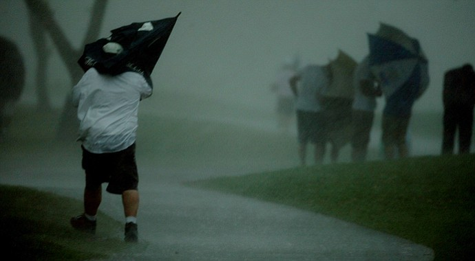 Spectators take cover during the final round at Arnold Palmer Invitational at Bay Hill.