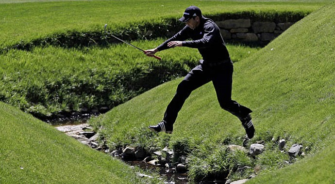 Sergio Garcia leaps over Rae's Creek during a practice round in 2011. Garcia will make his 15th consecutive appearance at the Masters, the longest in the field without having won a title.