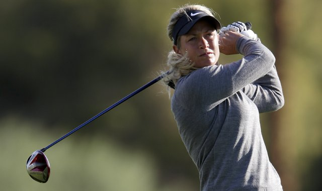 Suzann Pettersen watches her tee shot on the 11th hole during the first round of the LPGA Kraft Nabisco Championship.
