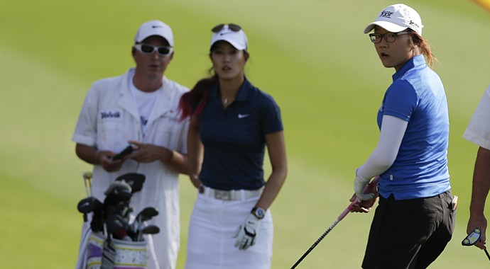 Lydia Ko (right) and Michelle Wie wait to hit on the 11th hole during the first round of the LPGA Kraft Nabisco Championship.