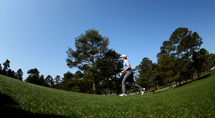 Rory McIlroy walks up a fairway during a practice round prior to the start of the 2013 Masters.