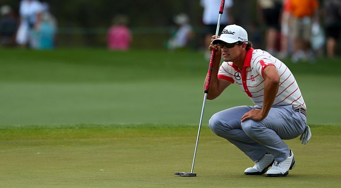 Adam Scott is using a Scotty Cameron Futura X Prototype, 52 inches in length so it can be used as a long putter.