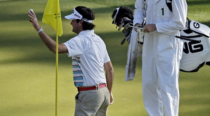 Bubba Watson acknowledges the crowd after making a hole-in-one on the 16th hole during Wednesday's practice round.