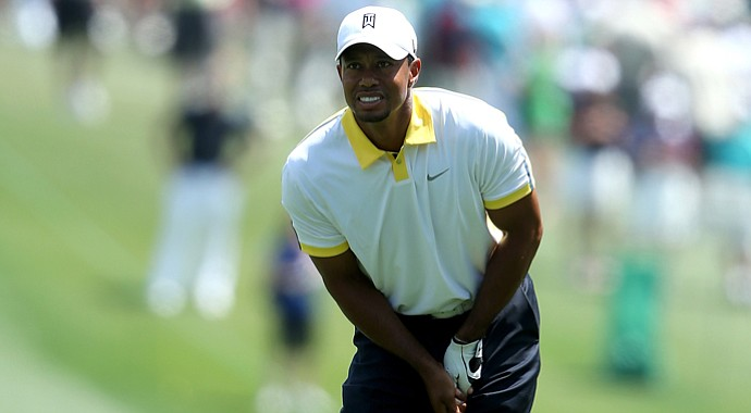 Tiger Woods watches a shot on the first hole during the second round of the 2013 Masters.