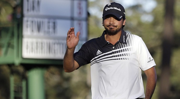 Jason Day waves after a birdie putt on the 16th green that moved him to 6 under at the Masters.