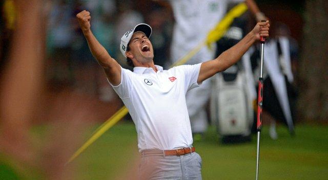Adam Scott celebrates his winning birdie putt on the second playoff hole of the 2013 Masters.