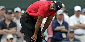 Woods makes a run, but runs out of holes at Augusta