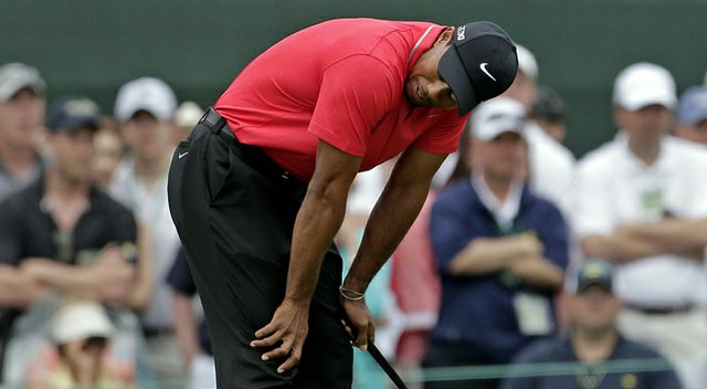 Tiger Woods reacts after missing a birdie putt on the first hole during the final round of the Masters Sunday at Augusta National.