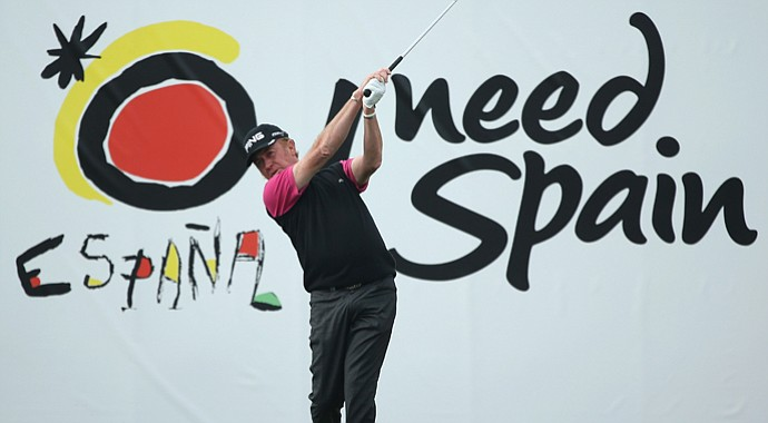 Miguel Angel Jimenez tees off during the Spanish Open, marking his return from a broken leg.