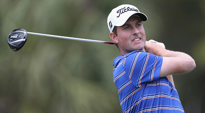 Webb Simpson hits a tee shot on the first hole during the final round of the RBC Heritage.