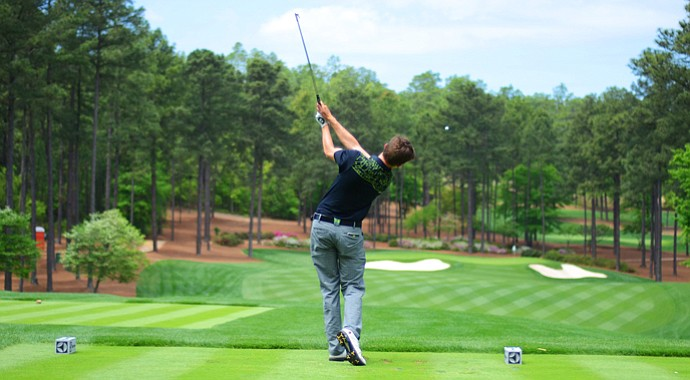 Matthew Fitzpatrick, of England, hits his tee ball at the par-3 16th hole during the junior-am at the Junior Invitational at Sage Valley on Thursday.