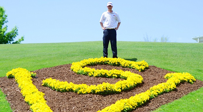 Defending champion Zachary Olsen, of Cordova, Tenn., poses in front of the clubhouse after his junior-am round at the Junior Invitational on Thursday.