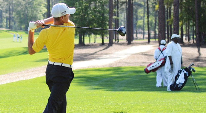 First Tee member Sam Wimbrow, 17, tees off on the 18th hole at Sage Valley on Thursday.
