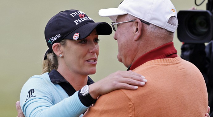 Cristie Kerr gets a hug from her father Michael Kerr as she celebrates winning the Kingsmill Championship. It was the first time that her father witnessed one of her wins in person.