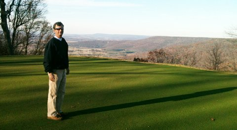 Matt Daniels, Sewanee's head professional, shares the legend of 'Shakerag Hollow' while admiring the view northward from the Gil Hanse-renovated course, which reopens in early June.