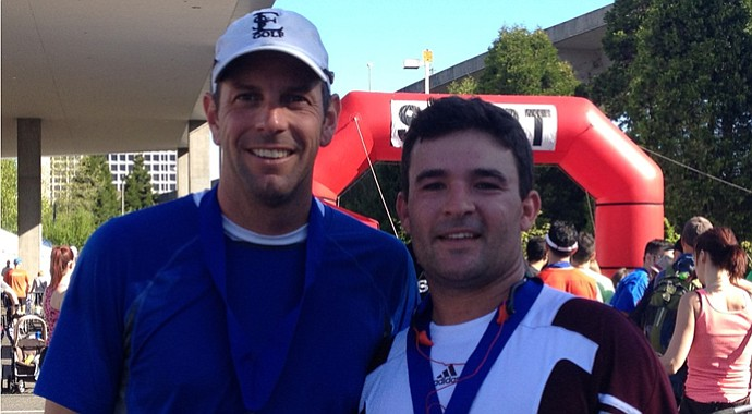 St. Edwards head coach Todd Ohlmeyer and assistant coach Chris Massoletti after completing the Tacoma City Half Marathon.