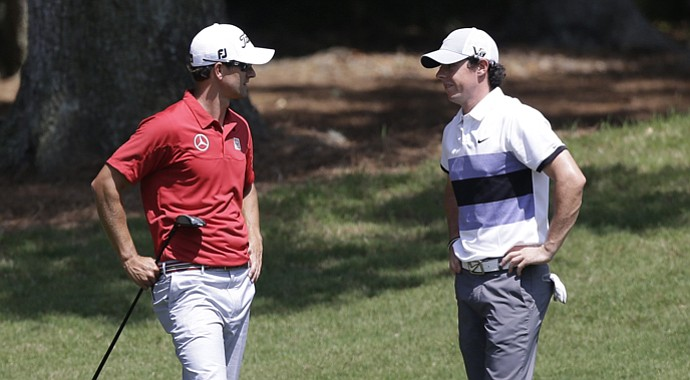 Adam Scott (left) and Rory McIlroy during the first round of the Players Championship.