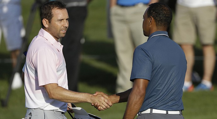 Sergio Garcia, left, shakes hands with Tiger Woods at the conclusion of the third round of the Players Championship.