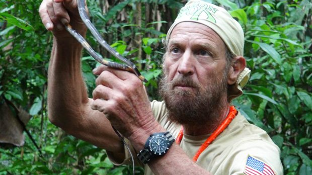 Cancer survivor Mickey Grosman holds a snake in the Amazon Rainforest, during a 5,000 mile South America trek.