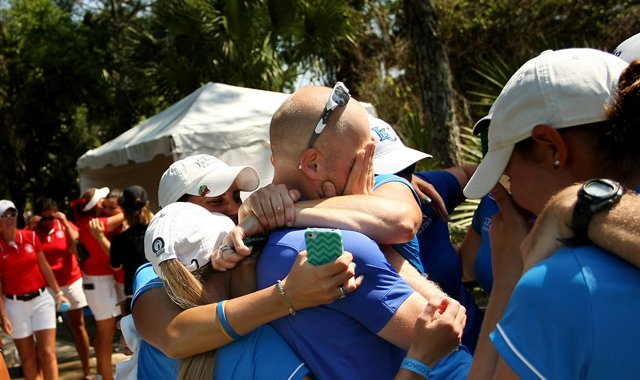The Lynn women&#39;s golf team surrounds head coach Danny Randolph after winning the NCAA Division II Women&#39;s National Championship.