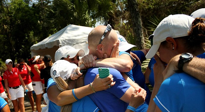 The Lynn women's golf team surrounds head coach Danny Randolph after winning the NCAA Division II Women's National Championship.