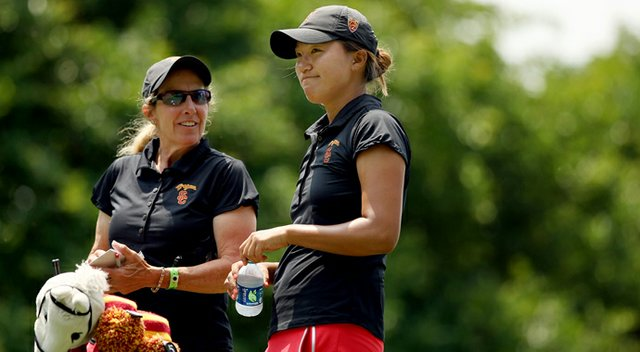 USC head coach Andrea Gaston talks with Annie Park at No. 8 in Round 2 of the 2013 Women's NCAA Championship. Park posted a 67.