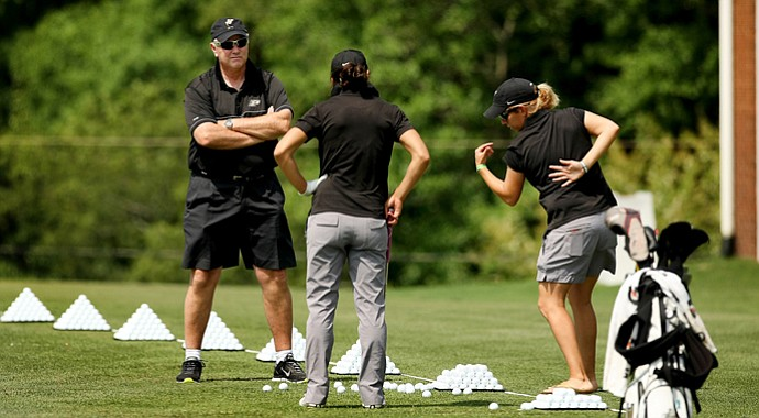 Purdue head coach, Devon Brouse (left) and assistant Caroline Haase (right) work with Paula Reto on the range in the second round of the 2013 Women's NCAA Championship.
