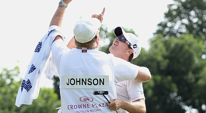 Zach Johnson celebrates on the 18th green with his caddie Damon Green after his one-stroke victory after the final round of the Crowne Plaza Invitational at Colonial at the Colonial Country Club. Green's father had passed away the previous week.