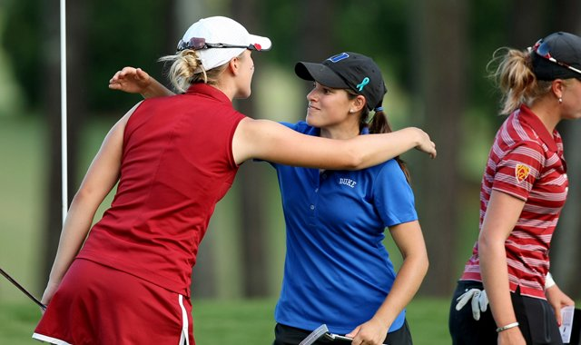 Duke's senior, Courtney Ellenbogen, center, hugs Alabama's senior, Jennifer Kirby, left, in Round 3 of the 2013 Women's NCAA Championship.