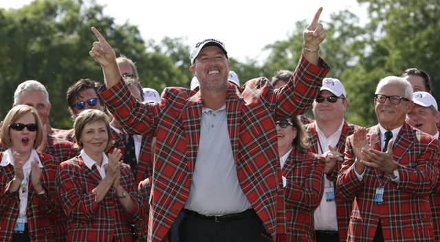 Boo Weekley celebrates after being presented the champion blazer after winning the Crowne Plaza Invitational at Colonial.