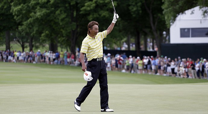 Kohki Idoki celebrates after making a putt for par on the 18th hole during the final round of the 74th Senior PGA Championship.