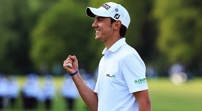 Matteo Manassero celebrates his victory after the fourth playoff hole at the BMW PGA Championship.
