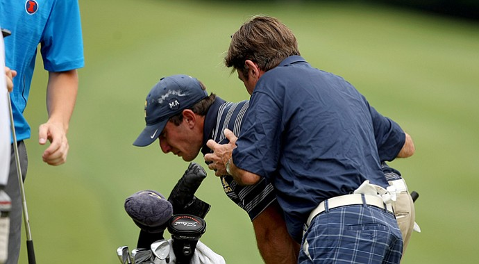 Cal's Max Homa is consoled by his father, John, after he lost his match in 20 holes to Illinois' Thomas Pieters during the semifinals of match play. Illinois advances to play Alabama in the final.