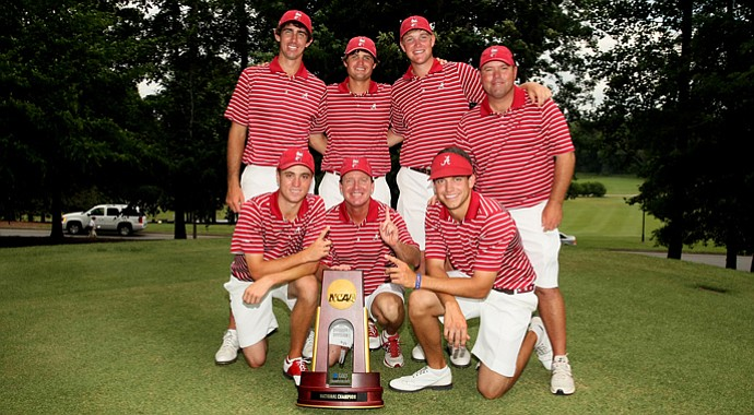 Alabama poses with the National Championship trophy. On the top row, from left, Scott Strohmeyer, Bobby Wyatt, Trey Mullinax and assistant coach Rob Bradley. On the bottom row, from left, Justin Thomas, head coach Jay Seawell and Cory Whitsett.