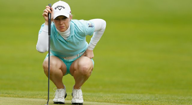 Morgan Pressel lines up a putt on the third green during the weather-delayed second round of the Wegmans LPGA Championship.