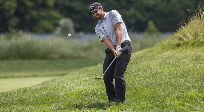 At rain-soaked Merion, where the rough around the greens is long and sticky, the lob wedge appears destined to play a pivotal role. Canadian Adam Hadwin practiced out of the rough on Tuesday afternoon.