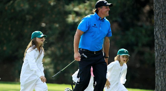 Phil Mickelson walks with his daughter Amanda (left) during the Par 3 Contest prior to the 2010 Masters.