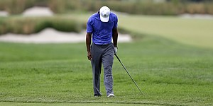 Rain, dark give Tiger seemingly needed breaks