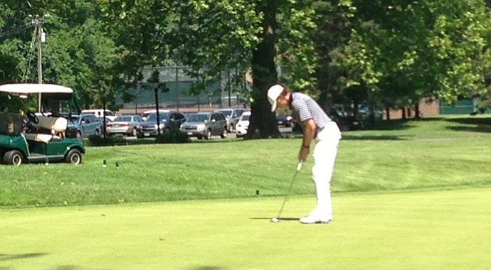 Nick Palladino stands over a putt at the Monroe Invitational.
