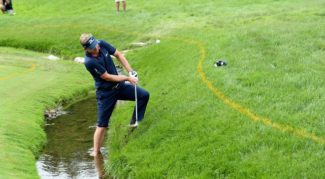 Luke Donald hits his fourth shot on the fourth hole during the final round of the U.S. Open at Merion Golf Club.