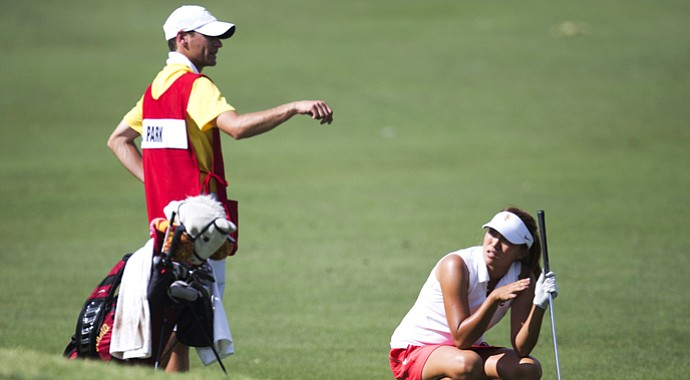 Annie Park gets advice from caddie Justin Silverstein, the assistant coach at USC.